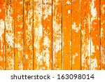 Orange Flaky Paint On A Wooden...