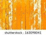 Orange Flaky Paint On A Wooden...