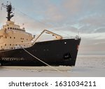 icebreaker in the port of Kemi, Finland, the water surface is covered with ice