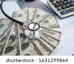 Stethoscope Over Pile Of Dolla...
