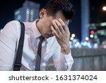 Asian Businessman Feel Depress...