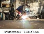 welder working in a steel... | Shutterstock . vector #163157231