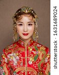 Small photo of Good looking traditional Asian matchmaker dress up