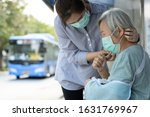 Small photo of Asian woman wearing medical face mask for senior person because sick female elderly with cough and fever,prevent spread of germs to other people at bus stop, Coronavirus,MERS-CoV,Wuhan Virus 2019-nCoV