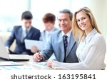 smiling business people with... | Shutterstock . vector #163195841