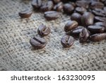 Coffee beans on sackcloth background - stock photo