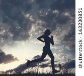 silhouette woman run under blue ... | Shutterstock . vector #163230851