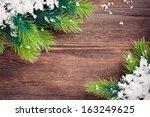 christmas fir tree border on a... | Shutterstock . vector #163249625