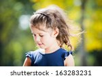 little european girl holding... | Shutterstock . vector #163283231