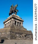Small photo of KOBLENZ, GERMANY - 7/6/2019: Equestrian bronze statue of Kaiser Wilhelm I on the Deutsches Eck