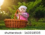 cute baby is playing in the park | Shutterstock . vector #163318535