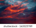 Sunset Sky With Dark Clouds