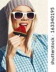 young woman sucking a lollipop. ... | Shutterstock . vector #163340195