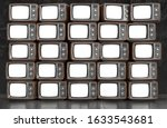 wall of old tvs with white... | Shutterstock . vector #1633543681