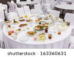 Waste Food On Round Table Afte...