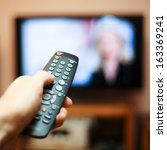 watching tv and using remote... | Shutterstock . vector #163369241