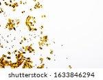 Golden confetti on a white...