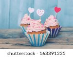 photo of 3 cupcakes on wooden... | Shutterstock . vector #163391225