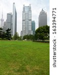 the grass and the city in... | Shutterstock . vector #163394771