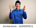 young mechanic man wearing blue ... | Shutterstock . vector #1634039311