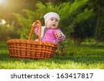 cute baby in basket in the... | Shutterstock . vector #163417817