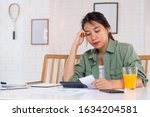 stressed asian woman serious... | Shutterstock . vector #1634204581