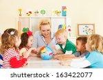 multicultural childrens hands... | Shutterstock . vector #163422077