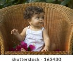 Infant Sitting On A Big Wicker...
