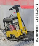 Small photo of Tamping Machine, vibratory hammer power tool at construction site