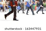 a large group of people walking.... | Shutterstock . vector #163447931