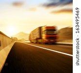 red truck on blurry asphalt... | Shutterstock . vector #163495469