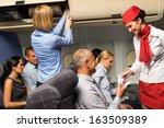 air stewardess check passenger...   Shutterstock . vector #163509389