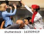 friendly flight attendant... | Shutterstock . vector #163509419