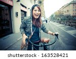 beautiful red head womanon bike ... | Shutterstock . vector #163528421
