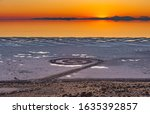 Small photo of Sunset over the Spiral Jetty, a giant earthwork sculpture by Robert Smithson in the Great Salt Lake of northern Utah, United States.