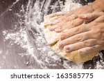 Kneading Dough On Wooden Board