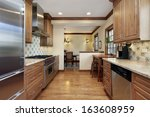 kitchen in home with oak wood... | Shutterstock . vector #163608959