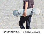 Shabby Skateboard In Hand Of...