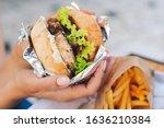 Female Hands Holding Burger ...
