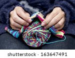Close Up Of Hands Knitting...