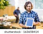 mid adult carpenter displaying... | Shutterstock . vector #163658414