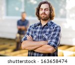 portrait of young carpenter... | Shutterstock . vector #163658474