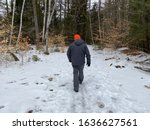 Man hiking in the snow in New London New Hampshire.