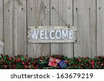 wood welcome sign with red and... | Shutterstock . vector #163679219