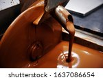 Small photo of Lifestyle food photography of chocolate tempering in a tempering machine in a chocolate factory