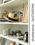 White Shelving Unit With Straw...