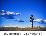 Hunter with Powerful Rifle with Scope Spotting Animals. Hunter with shotgun gun on hunt. Copy space for text. Most realistic hunting game ever created - stock photo