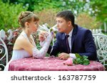 bride and groom in the park  a... | Shutterstock . vector #163787759