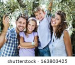 family having fun with in a... | Shutterstock . vector #163803425