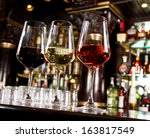 three glasses of wine on the... | Shutterstock . vector #163817549